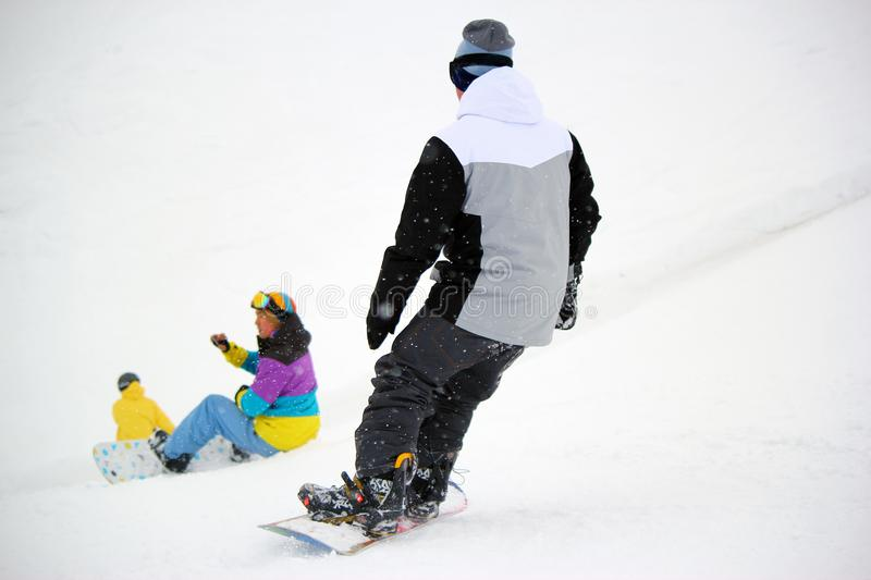 Snowboarder in motion, the snowboarder on the ski slope royalty free stock photo
