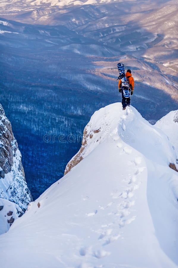 Snowboarder in the mountains. stock photos