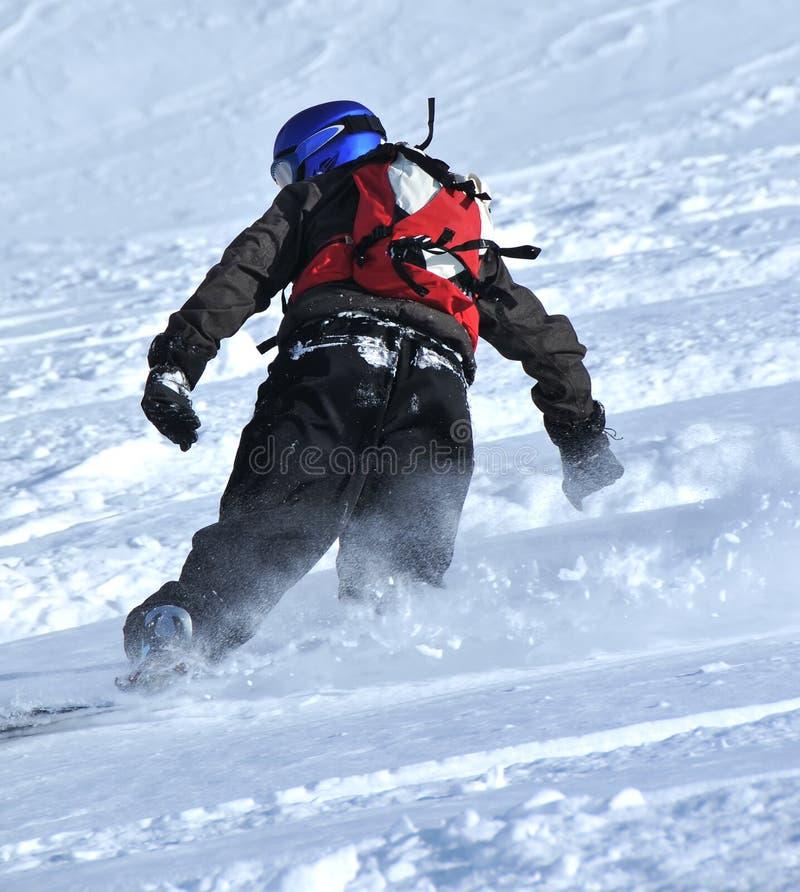 Snowboarder na neve do pó imagens de stock royalty free