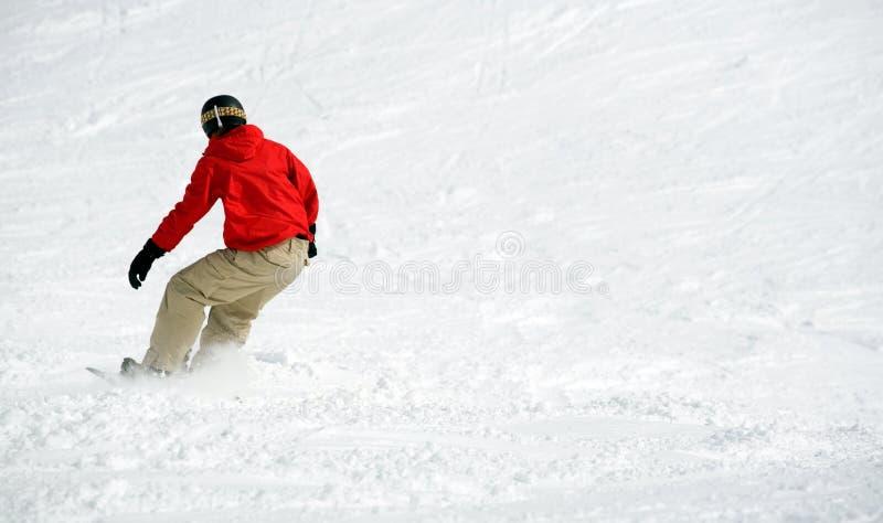 Snowboarder na neve. Lotes do espaço fotos de stock royalty free