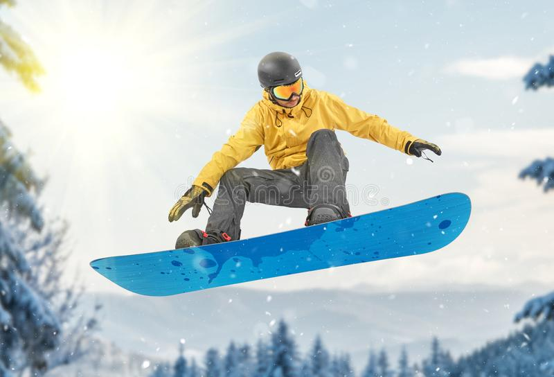 Snowboarder performing a jump stock images