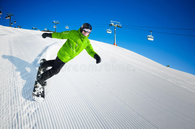 Snowboarder On Piste In High Mountains Royalty Free Stock Images