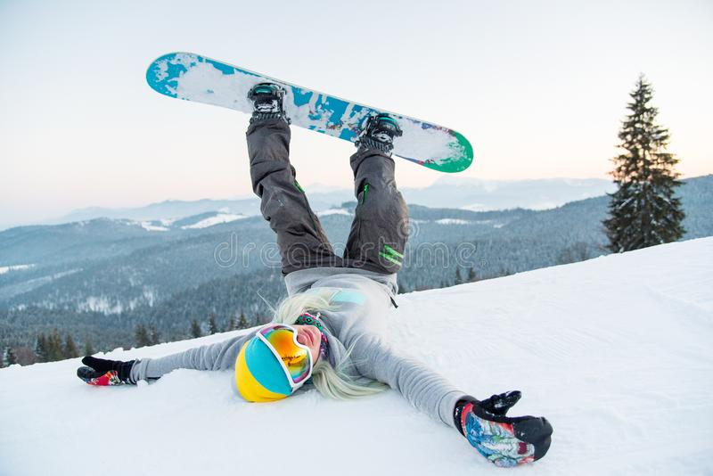 Snowboarder resting in the mountains stock image