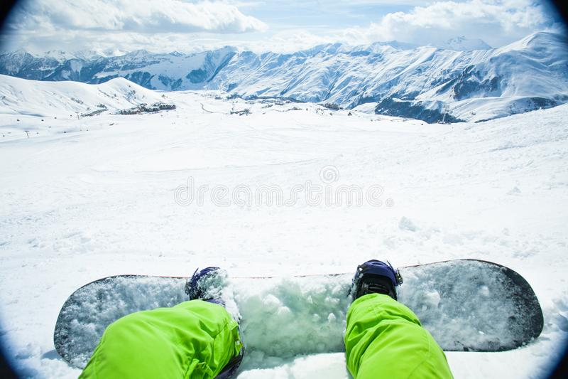 Snowboarder sitting on relax moment in mountain stock photos