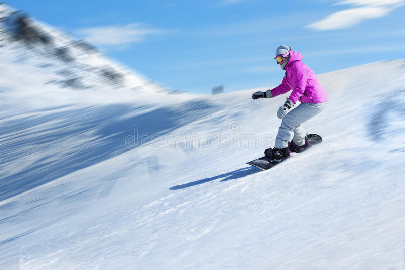 Snowboarder at a ski resort royalty free stock images