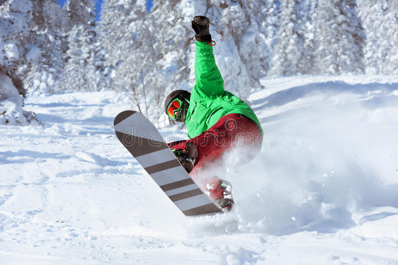 Snowboarder skier jumps freeride forest stock images