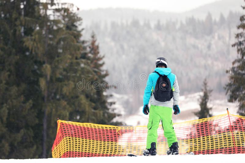 Snowboarder on slope at resort, space for text. Winter. Vacation royalty free stock image