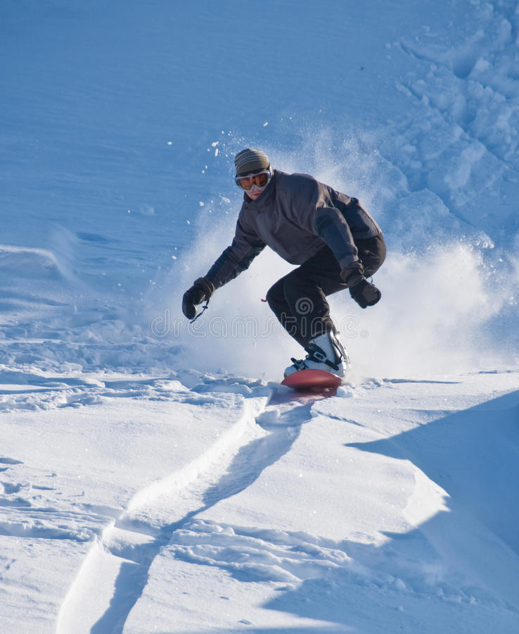 Snowboarder Speeding Downhill stock photo