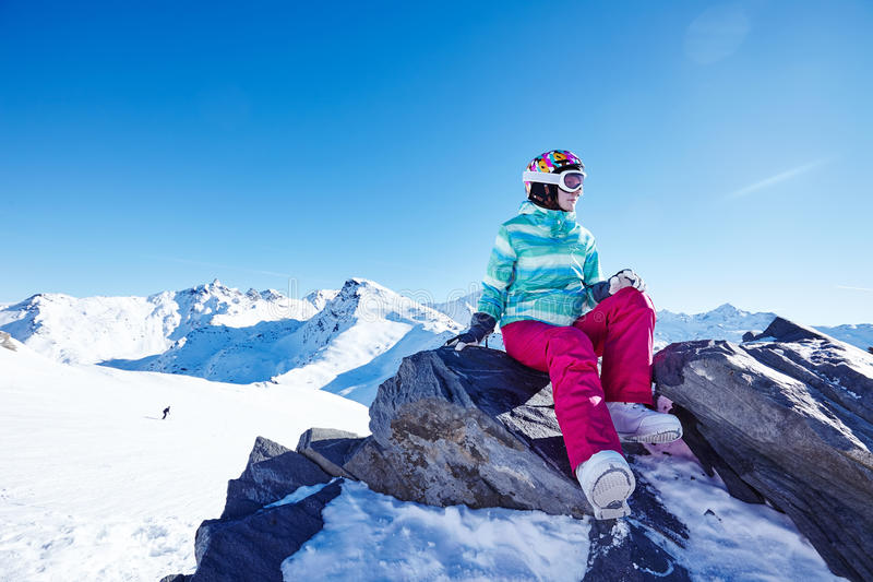 Snowboarder on stone royalty free stock photography