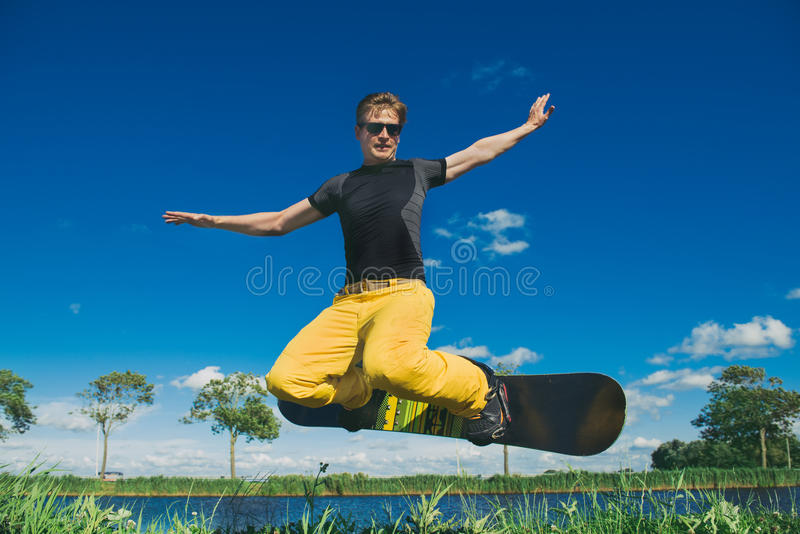 Snowboarder in summer royalty free stock image