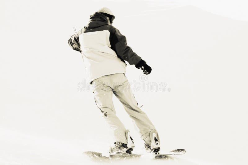 Snowboarder sur la neige photos stock