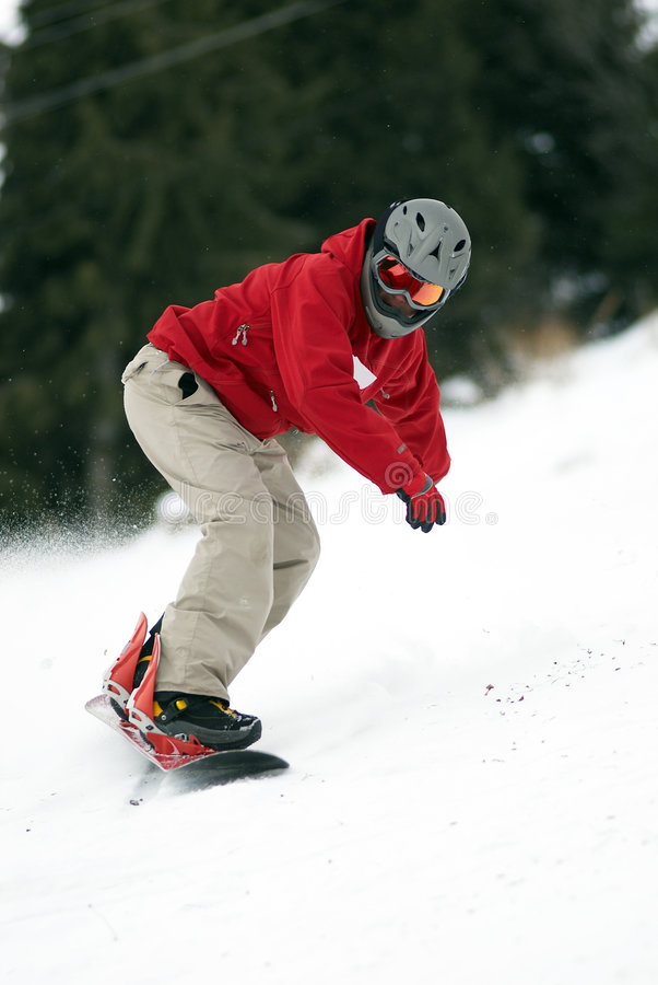 Snowboarder sur le chemin photo stock