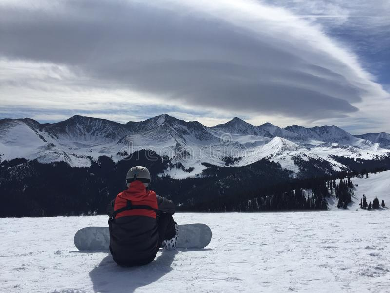 Snowboarder on top of the mountain stock images