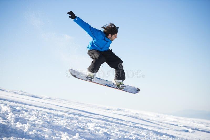 Snowboarderbanhoppning arkivbilder