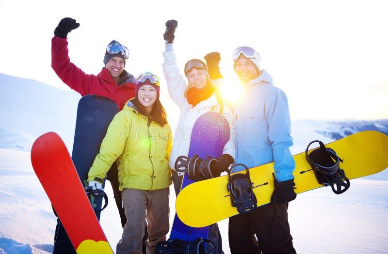 Snowboarders bovenop de Berg stock afbeelding