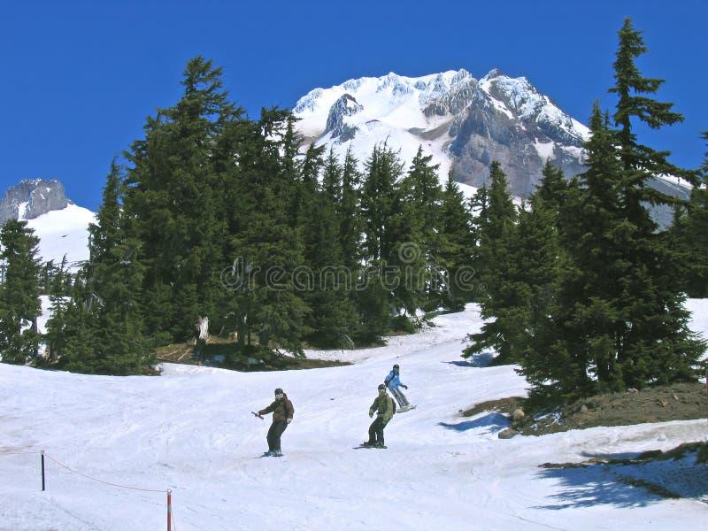 Snowboarders, capo motor del Mt., Oregon fotografía de archivo