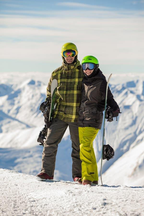 Snowboarders chanceux de couples images libres de droits