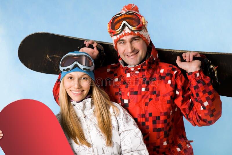 Snowboarders felices imagen de archivo libre de regalías