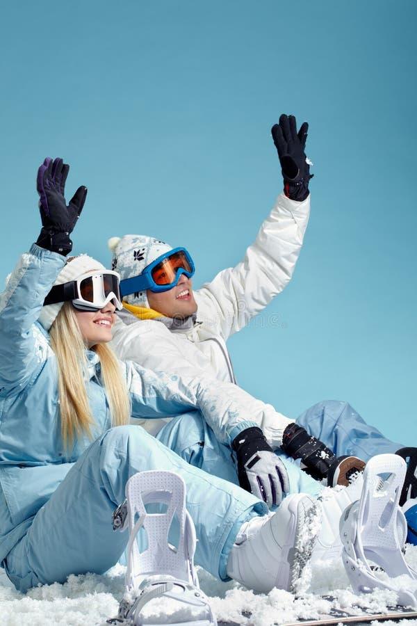 Snowboarders que agitan fotos de archivo
