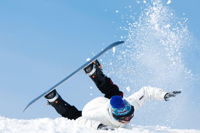 Snowboardextremfallen stockfoto