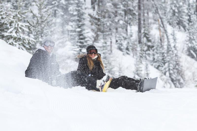Snowboarding coulple stock afbeelding
