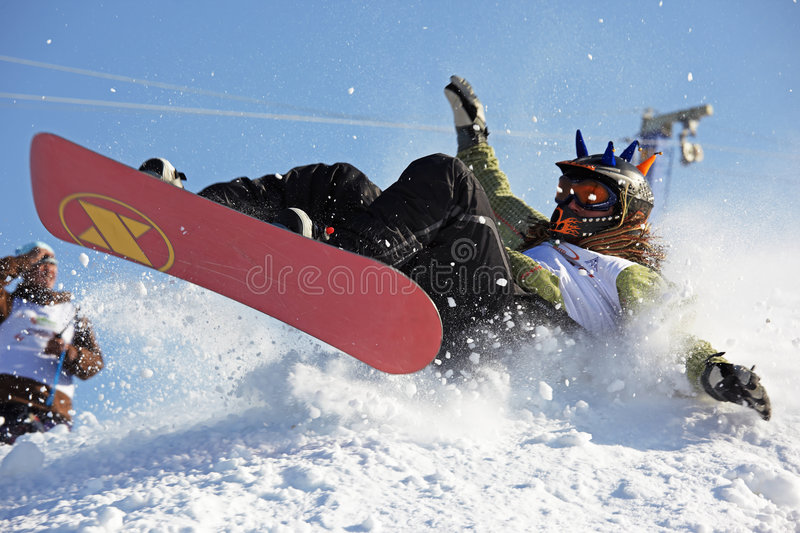 Snowboarding extreme fall royalty free stock photography