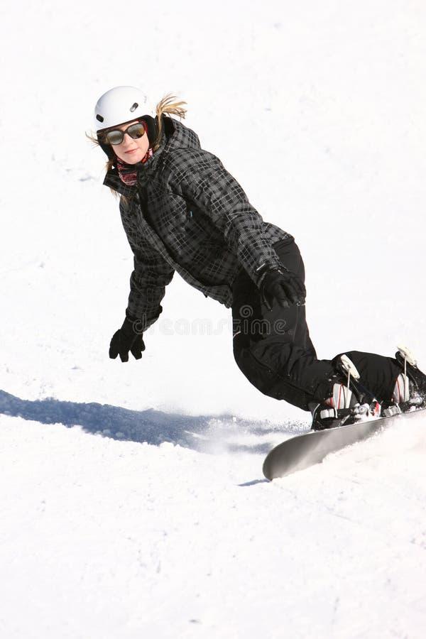 A snowboarding girl stock photos