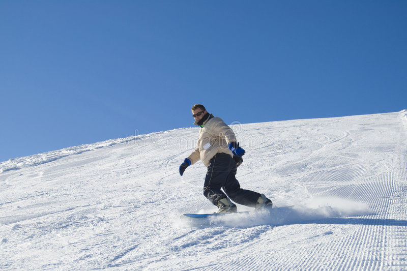 Snowboarding in the mountain stock photo royalty free stock image