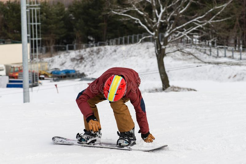 Snowboarding with mountains stock photo