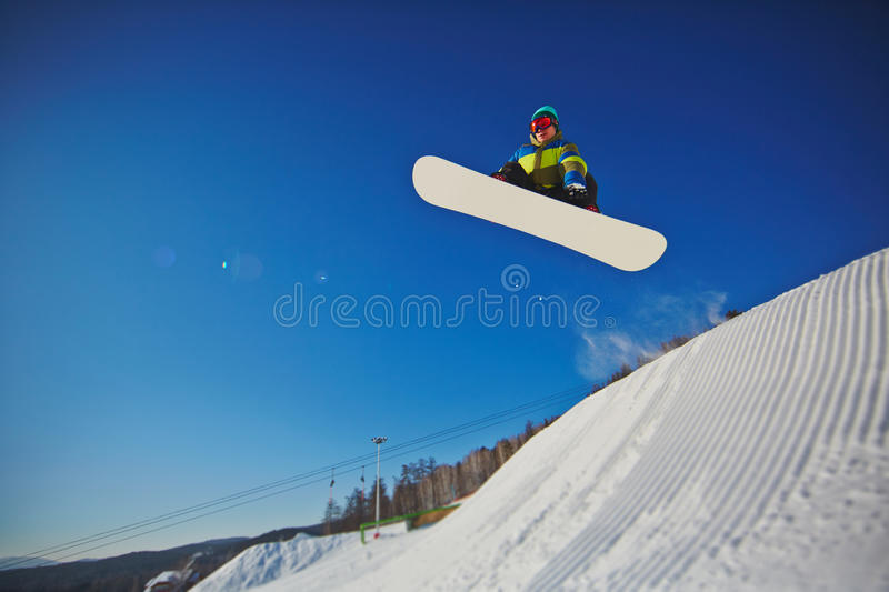 Snowboarding at resort stock photography