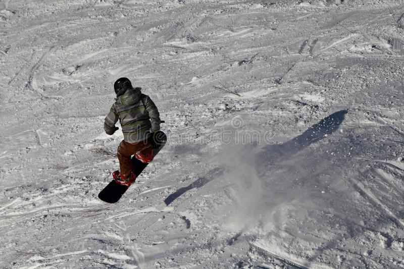 Snowboarder lunched up high in the air. View from above stock photography