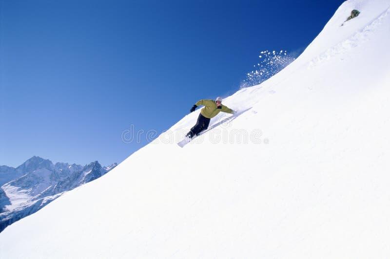 snowboardingkvinnabarn arkivfoton