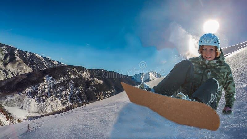 Snowboardingsvrouw stock afbeelding