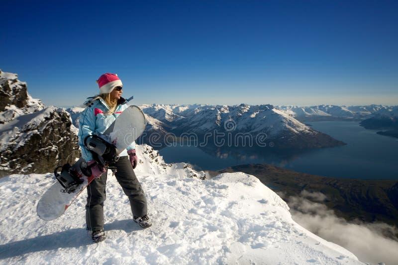 Snowboardmädchen lizenzfreies stockbild