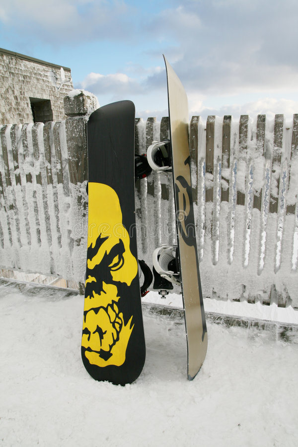 Snowboards On The Fence Royalty Free Stock Image