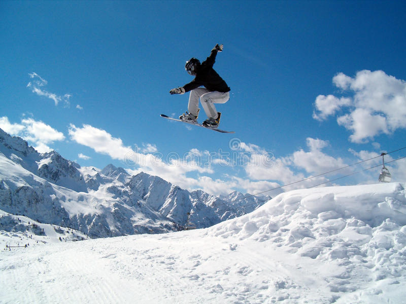 Download Snowborder (girl) jumping stock image. Image of italy - 10772729