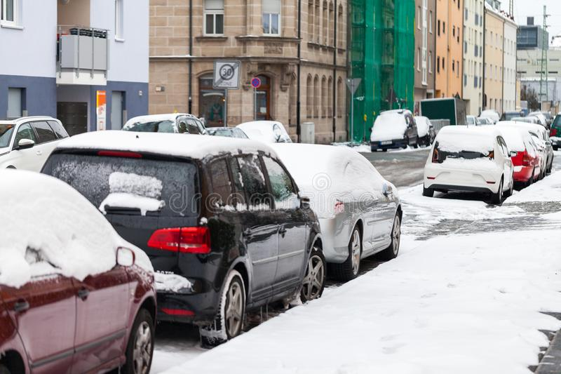 Snowbound cars parked at the roadside stock photography