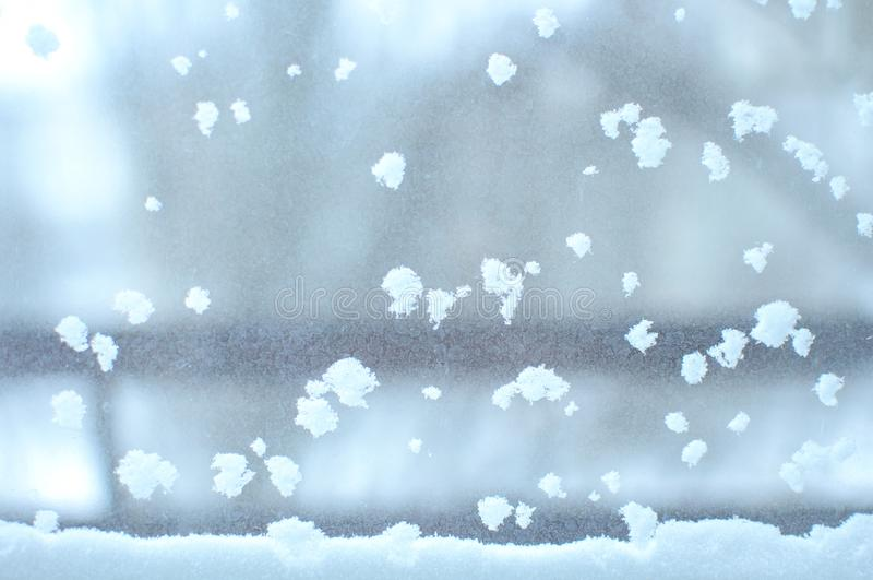 Snowbound window close-up, indoor. Seasonal winter weather conditions. Snowy winter background royalty free stock photo