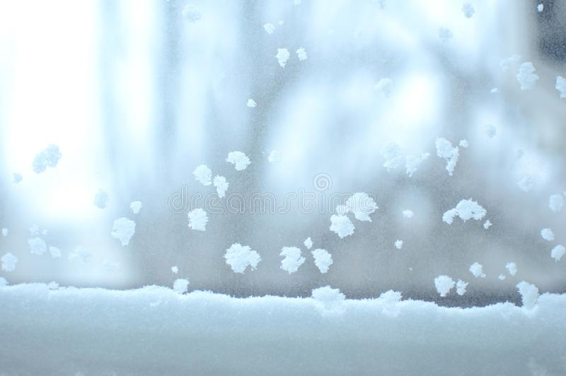 Snowbound window close-up, indoor. Seasonal winter weather conditions. Snowy winter background royalty free stock photography