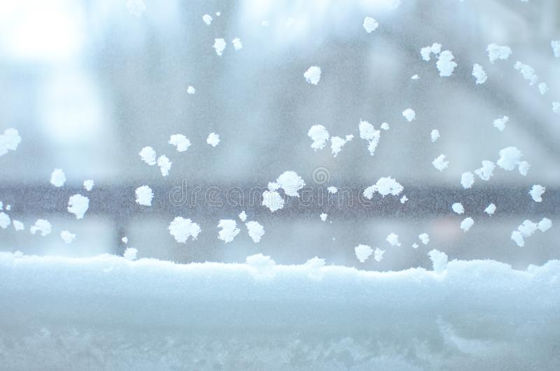 Snowbound window close-up, indoor. Seasonal winter weather conditions. Snowy winter background royalty free stock image
