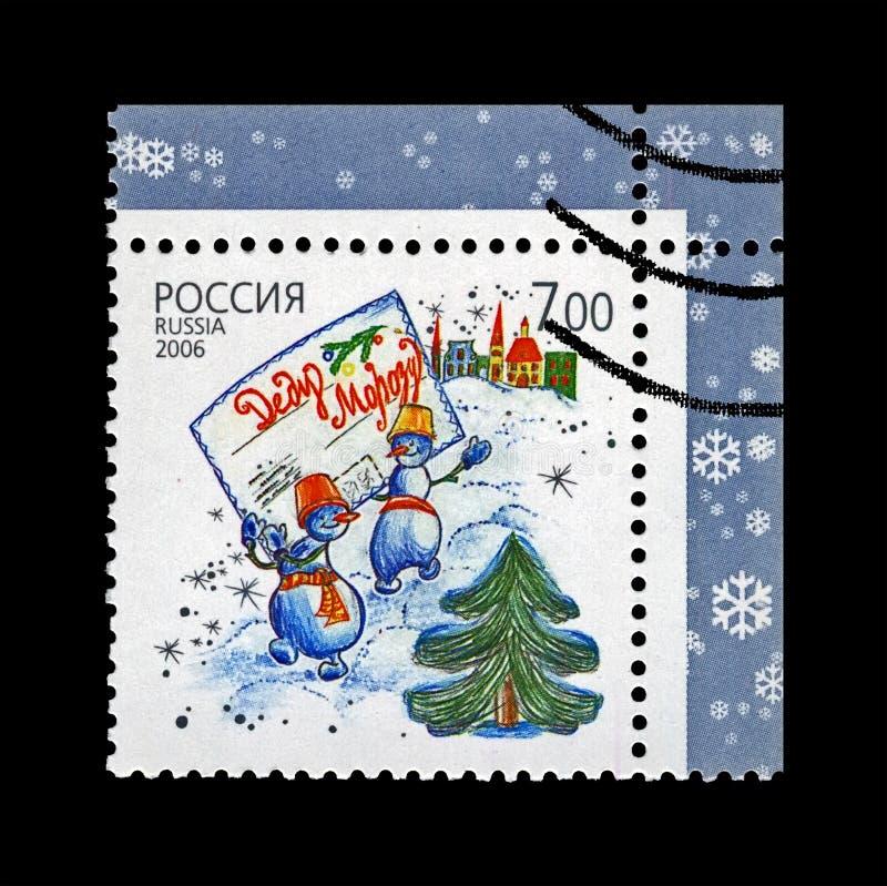 Snowboys con la busta per generare Frost aka Santa Claus, fiocco di neve per il Natale, Russia, circa 2006, immagine stock libera da diritti