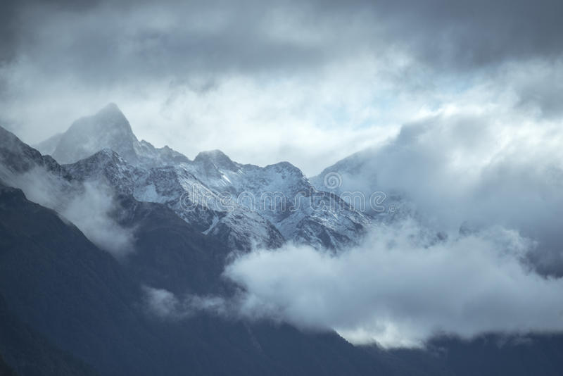 Snowcapped mountain range at Milford sound. stock images