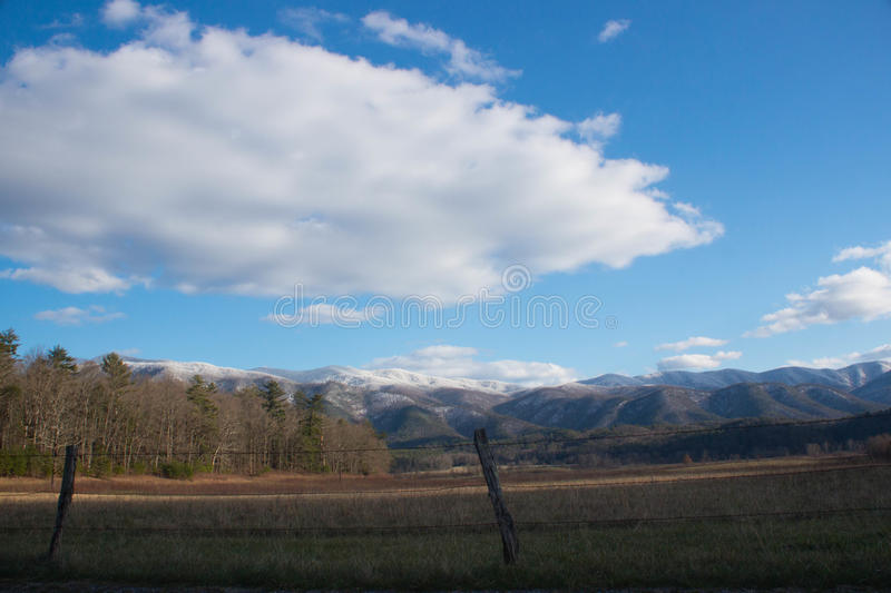 Snowcapped Mountain View in Cade`s Cove. Sweeping view of a snowcapped mountain along the Cade`s Cove loop in The Great Smoky Mountains National Park stock image