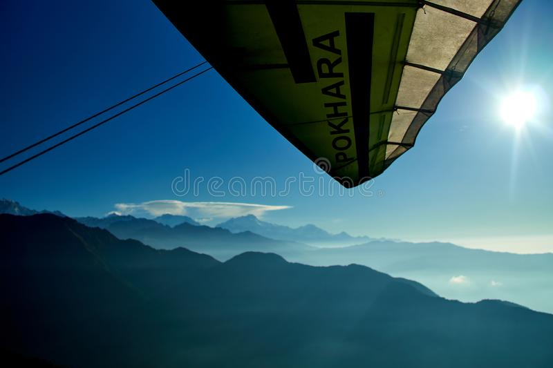 Ultralight aircraft and trees and snowcapped peak at background in the Himalaya mountains, Nepal royalty free stock photos