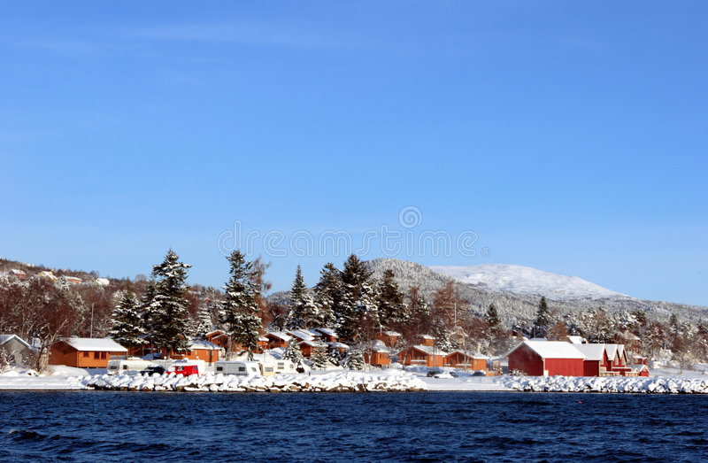 Snowcovered Cabins At The Fjord Royalty Free Stock Image