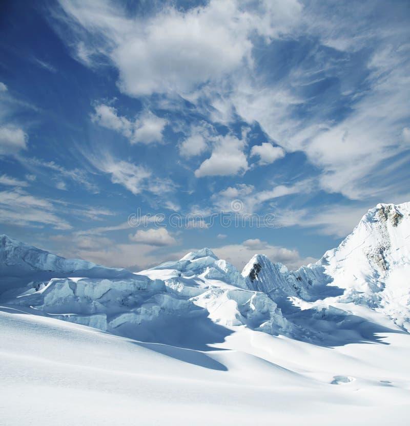 Snowcovered mountain. Snowcovered high mountain in Cordilleras stock photos