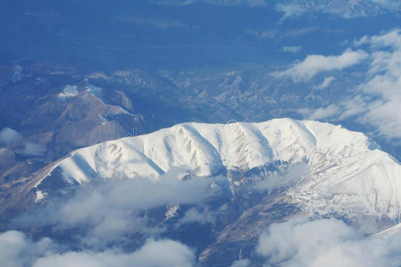 Snowcovered mountain. Snowcovered high mountain royalty free stock photo