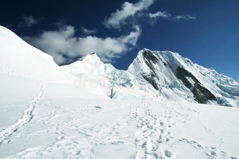 Snowcovered mountain. Snowcovered high mountain in Cordilleras stock photography