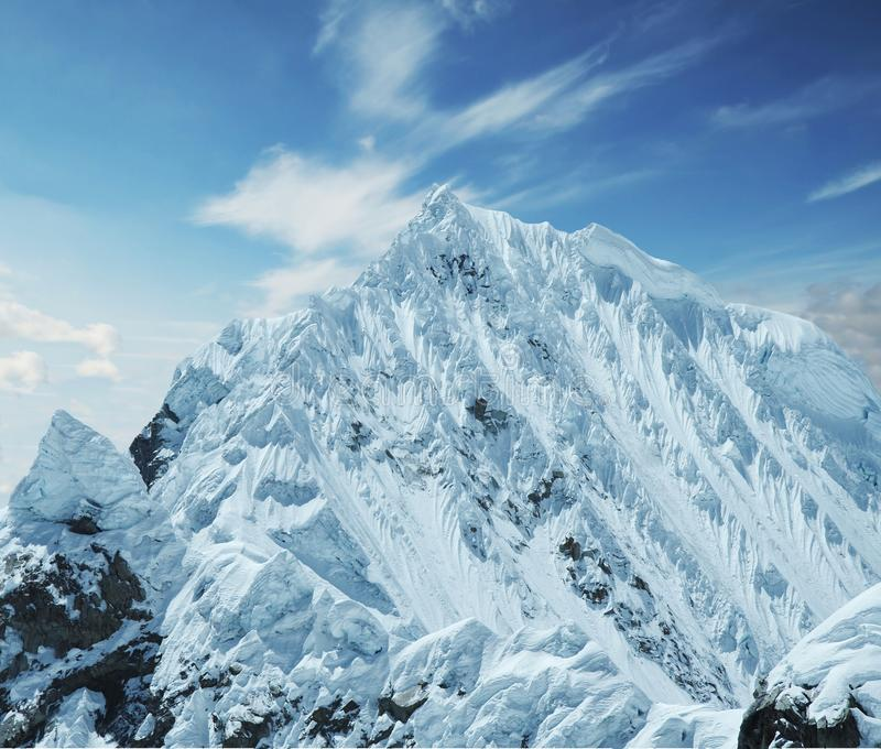 Snowcovered mountain. Snowcovered high mountain in Cordilleras stock images