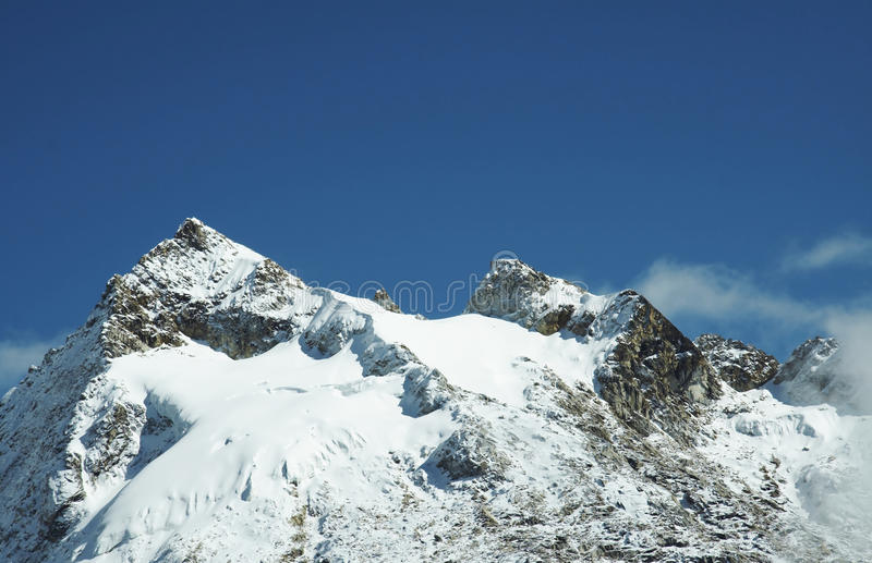 Snowcovered mountain. Snowcovered high mountain in Cordilleras stock photo